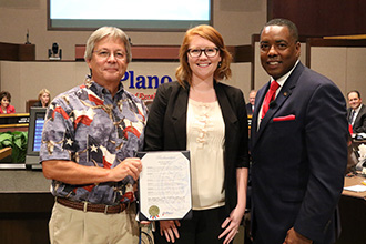 Larry Howe, Plano Solar Advocates volunteer, recieving Plano's DFW Solar Tour Day Proclamation from Autumn Natalie, Plano Environmental Education Coordinator, and Harry LaRosiliere, Plano Mayor.