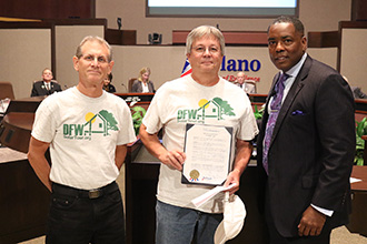 Robert Litwins, Plano Solar Advocates volunteer and DFW Solar Tour Leader, and Larry Howe, Plano Solar Advocates volunteer, recieving Plano's DFW Solar Tour Day Proclamation from Harry LaRosiliere, Plano Mayor.